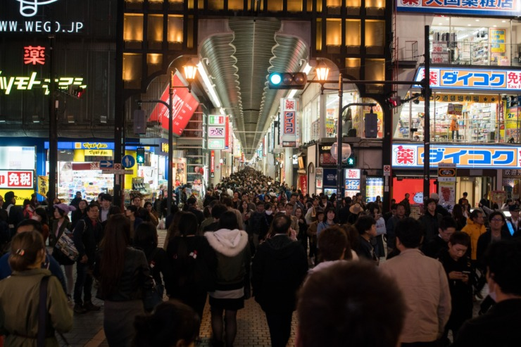 Crowds of shoppers head into a mall in Japan