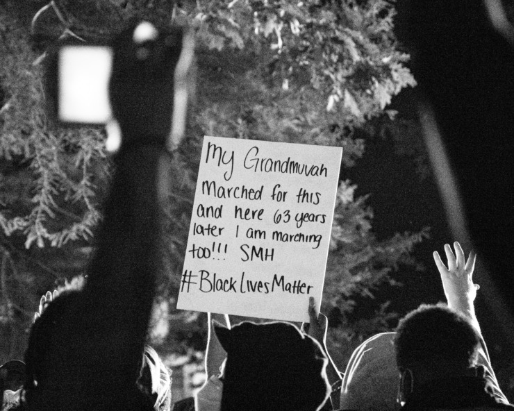 """A sign reads """"my grandmuvah marched for this and here 63 years later I am marching too!!! SMH"""""""