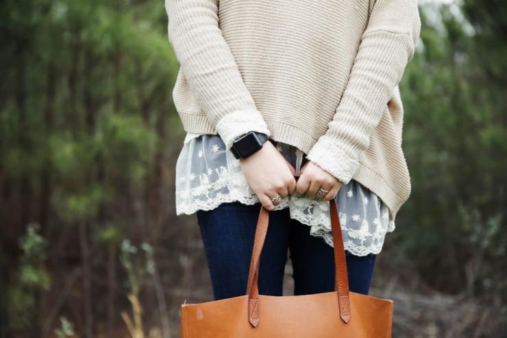 A woman wears an Apple watch