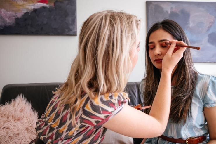 A Gen Z girl has her makeup done