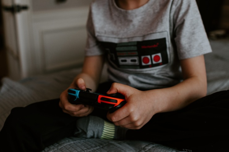 A Gen Z gamer uses a console