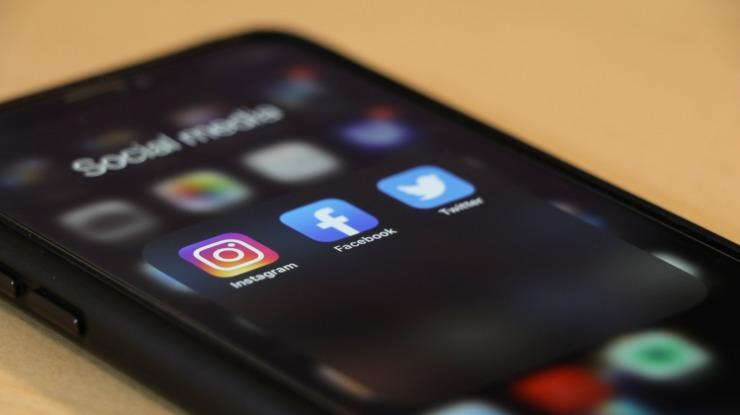 phone screen displaying three digital platforms