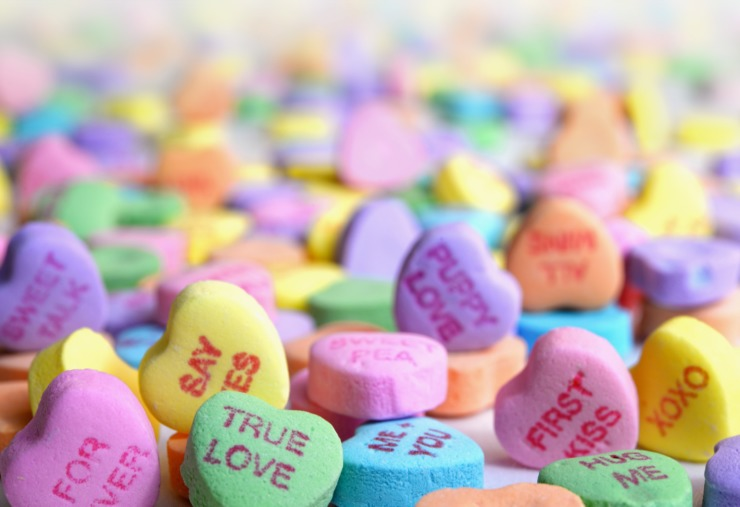 heart-shaped sweets with cute messages on them