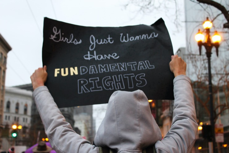 Protester holding up sign in favour of women's rights