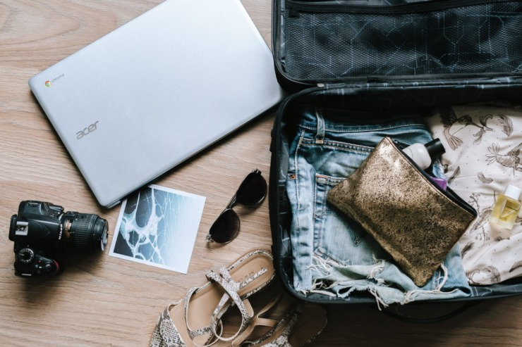 suitcase packed with travel accessories