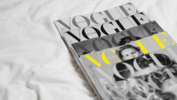 Vogue magazines stacked neatly together