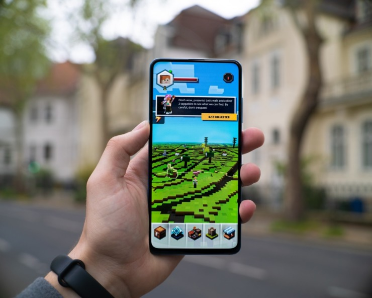a person holds up a mobile game