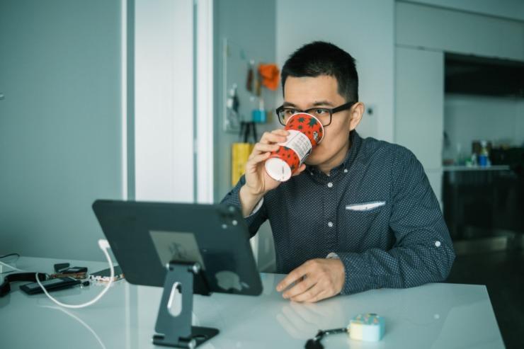 a boy uses tech to study remotely