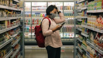 A student browses in a supermarket isle