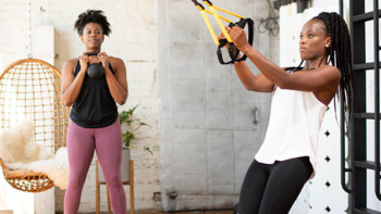 Two woman working out - TRX Training ad