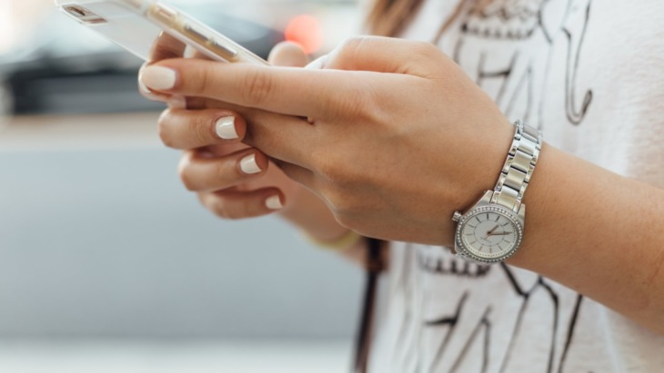close up image of hands holding a phone