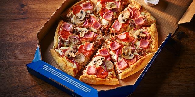 Domino's ham and mushroom pizza in a box