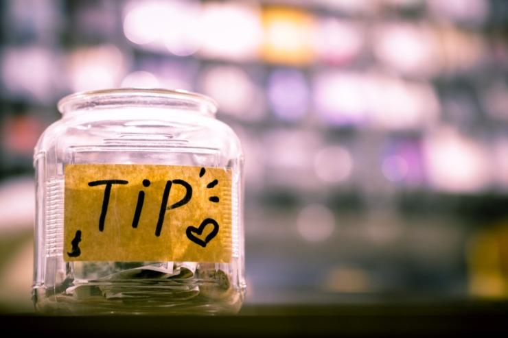 tip jar with change inside