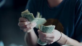 student counting dollar bills