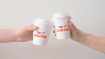 two Dunkin' Donuts coffee cups