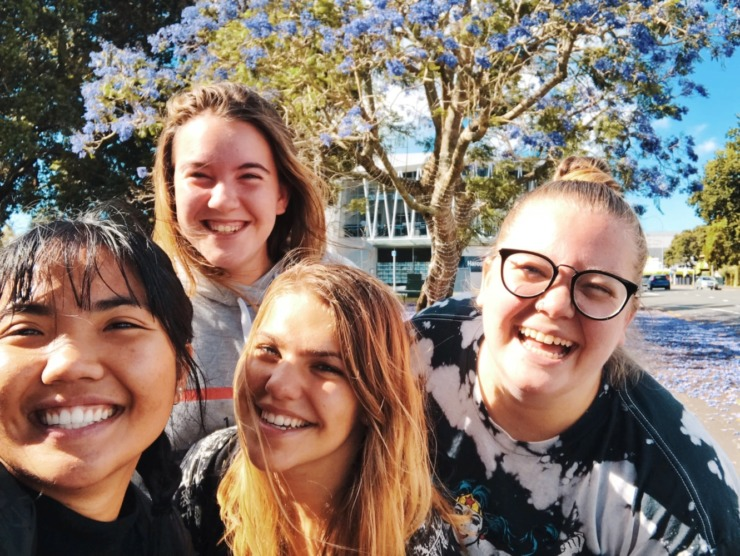 Group of students smiling in a selfie
