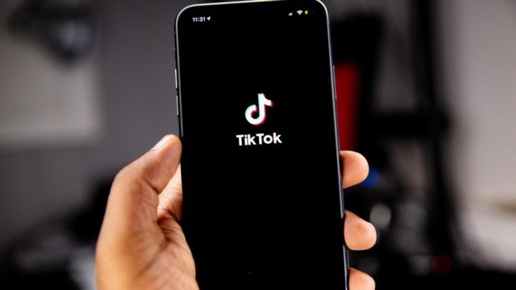 Phone screen featuring TikTok logo