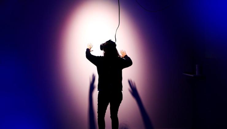 A woman wears a VR headset