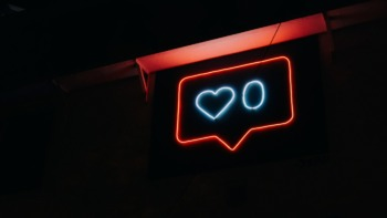 Neon sign of an Instagram 'Like' icon