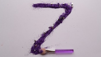 purple 'Z' drawn by a make up brush