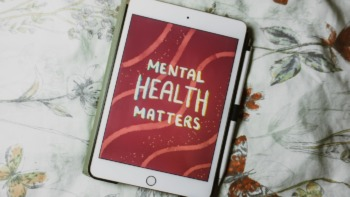 Ipad with a illustration that reads 'mental health matters'