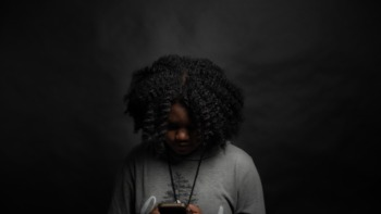 A girl browses her phone