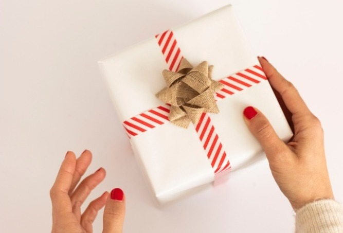 person holding a gift wrapped present