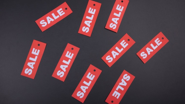 black background with red sale tags